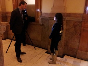 Fox 31's Eli Stokols conducts an interview after ASSET news conference.